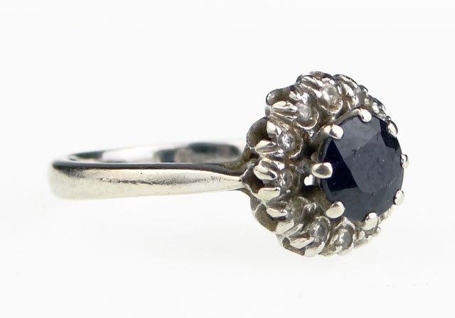18: Diamond, Sapphire and 18 Karat White Gold Lady's Ri