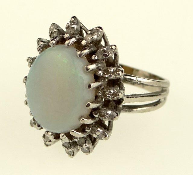19: Opal, Diamond and 14 Karat White Gold Ladies Ring.