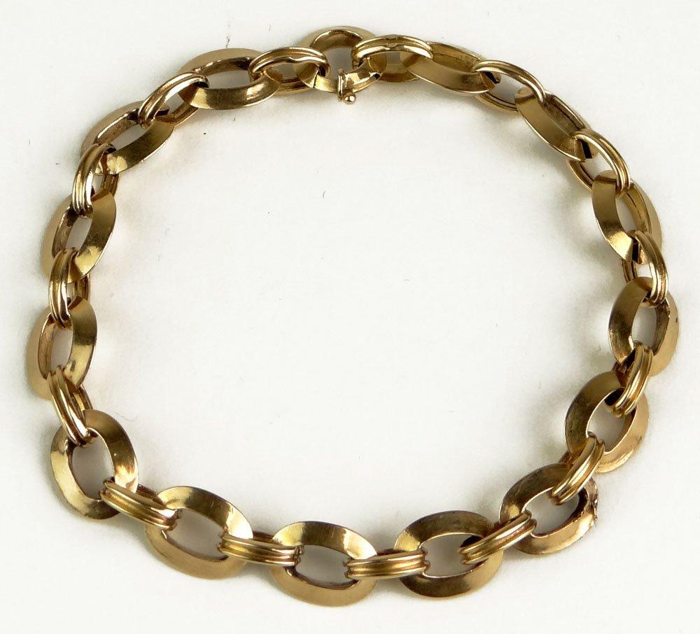 European 18 Karat Yellow Gold Charm Bracelet. Signed wi