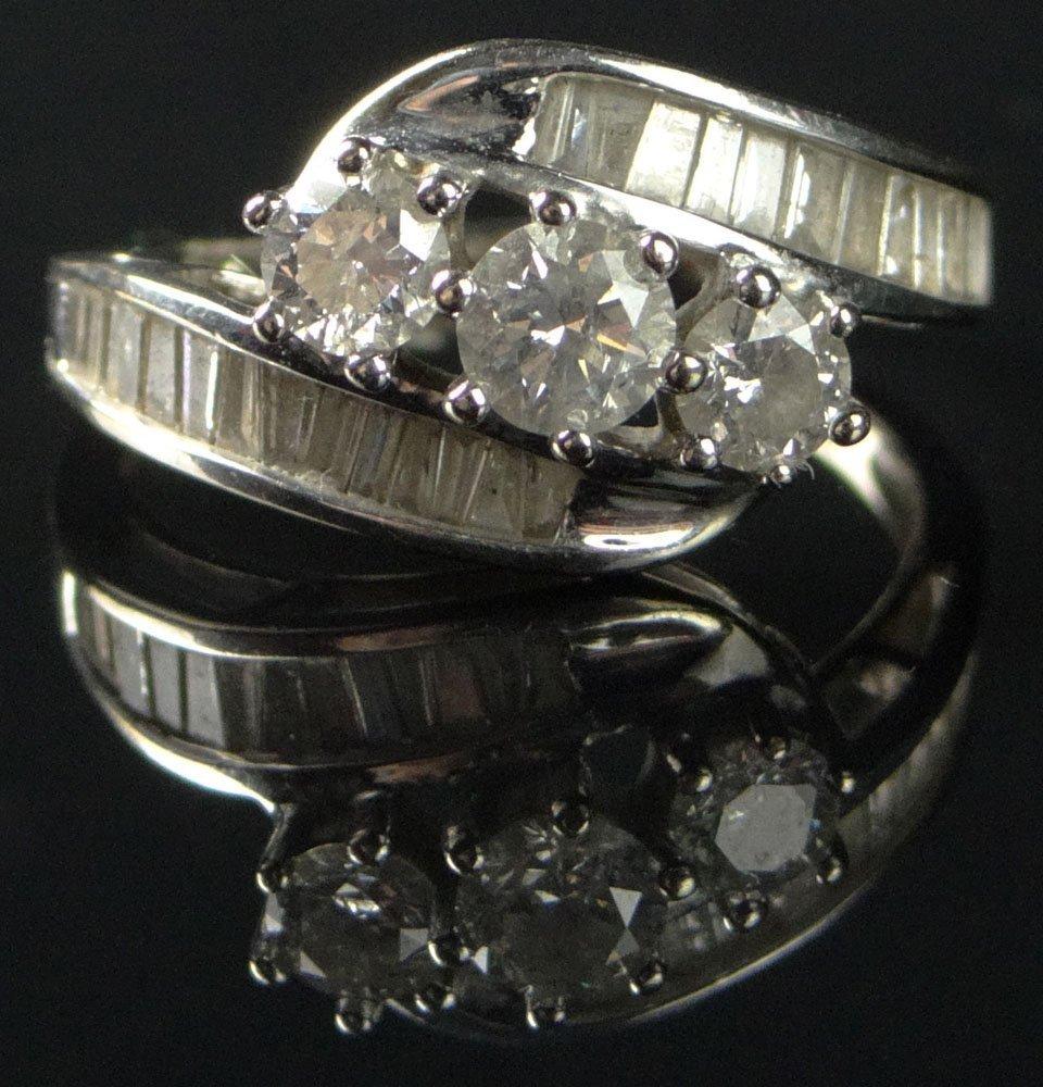 Lady's Round Brilliant Cut Three (3) Diamond Ring Set