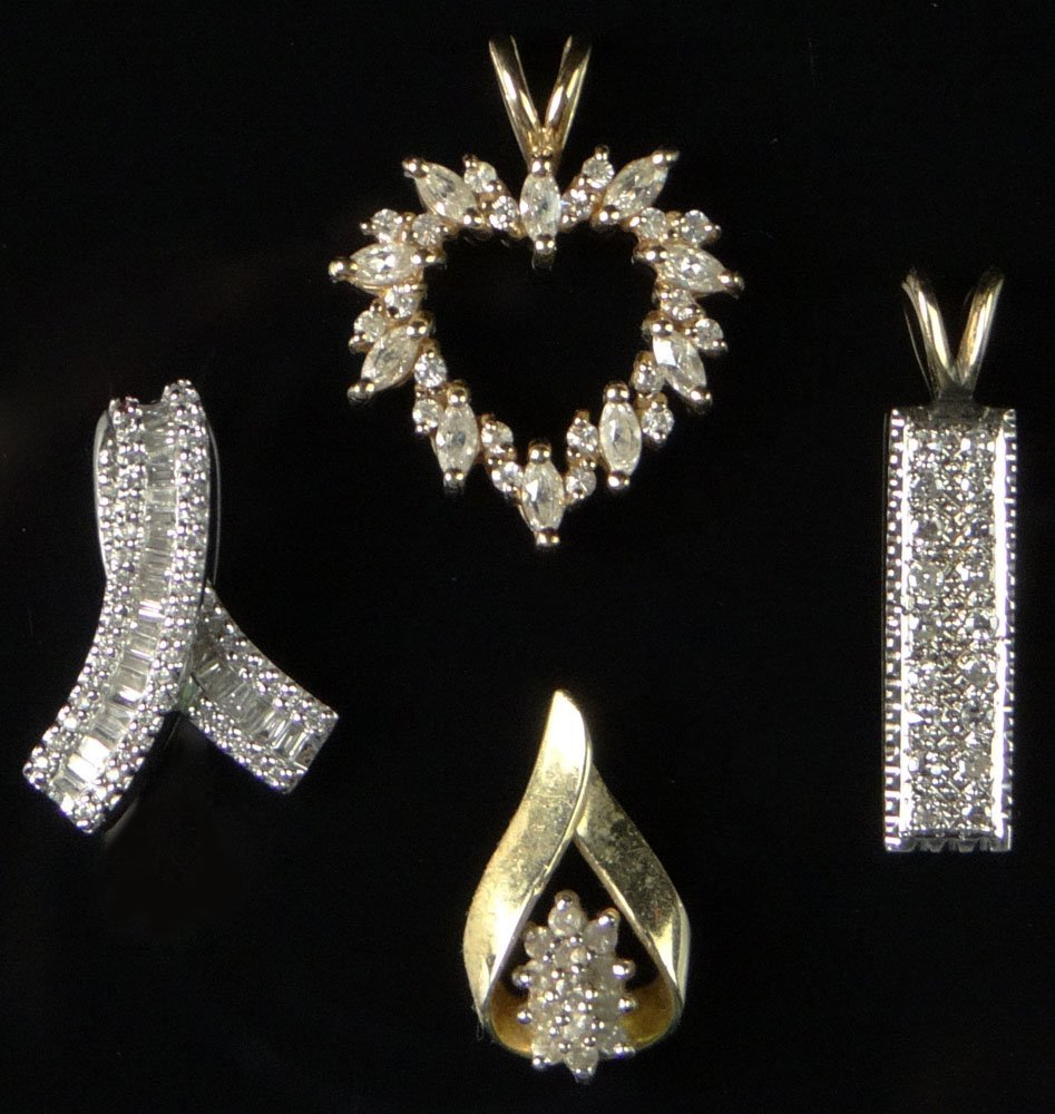 Four (4) Diamond and 14 Karat Gold Pendants. Including: