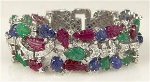 Cartier style Approx 7000 Carat Carved Emerald Ruby