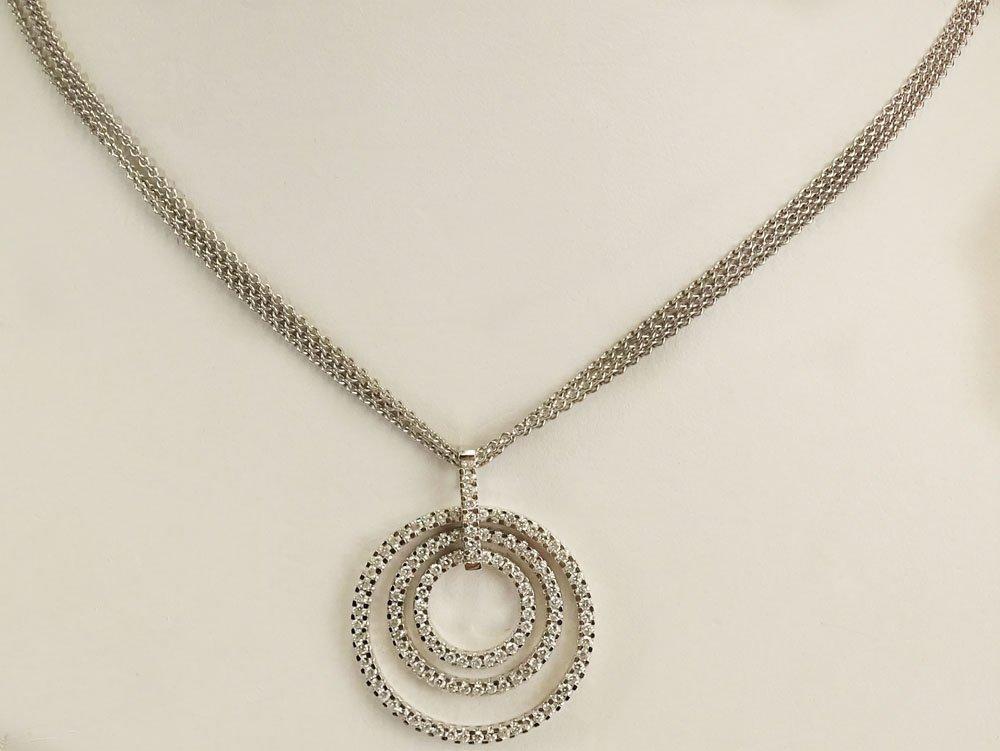 Movado Round Cut Diamond and 18 Karat White Gold