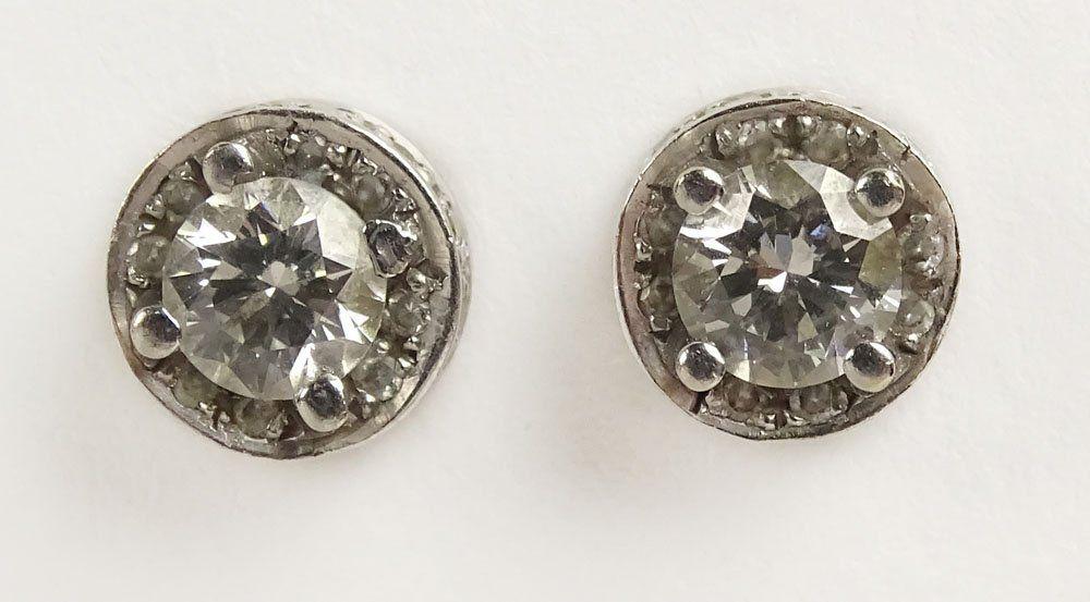 Pair of 18 Karat White Gold and Diamond Earrings. Each