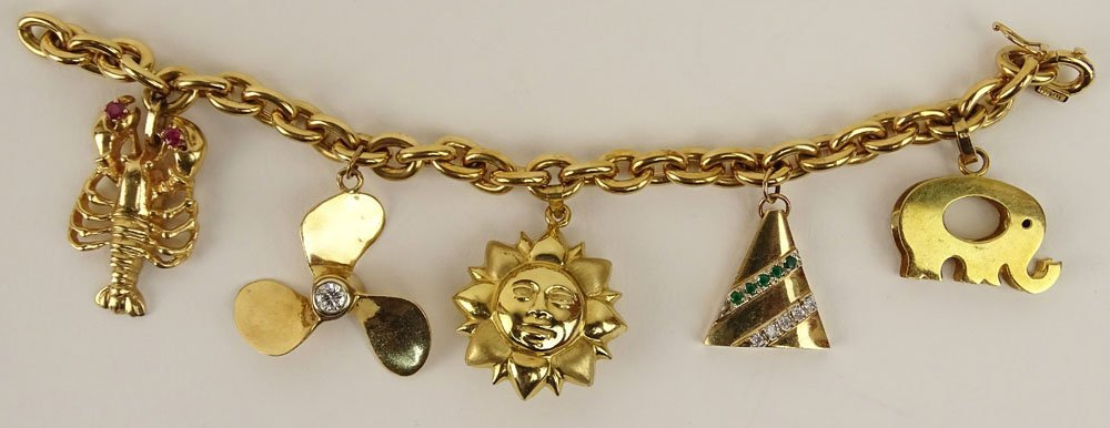 Lady's vintage 18 karat yellow gold charm bracelet with