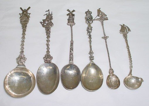 11: 6 .Continental and Sterling Silver Figural Spoons C