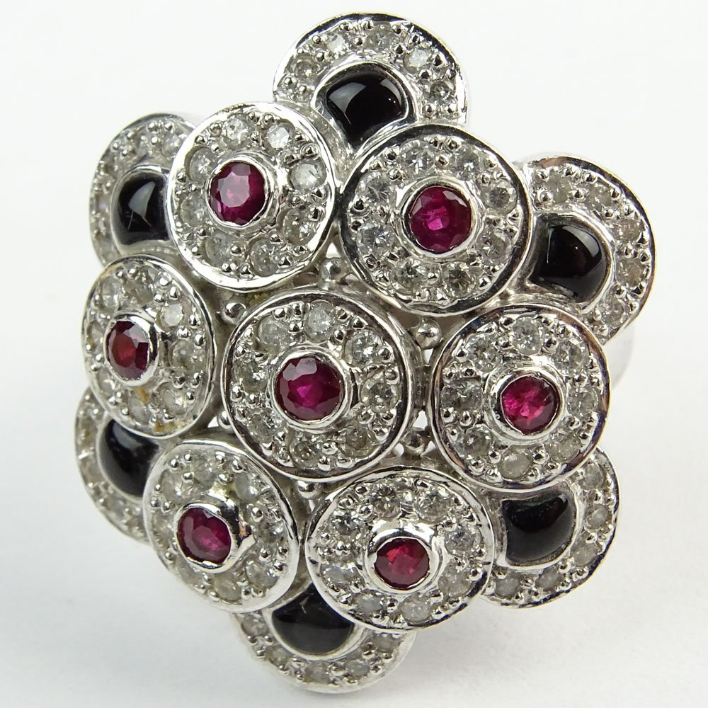 Diamond, Ruby, Black Onyx and 18 Karat White Gold Ring.