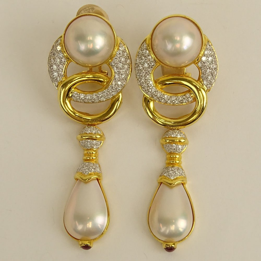 Pair of Mabe Pearl, Approx. 3.20 Carat Micro Pave Set