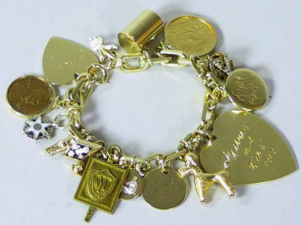 109: 14K Gold Charm Bracelet With 15 Charms