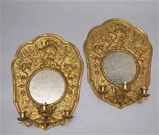 Pair Of Antique Brass Repousee Mirrored Sconces