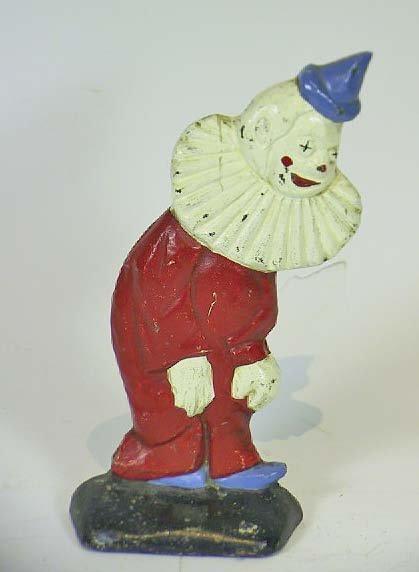 12: Cast Iron Signed Hubley Clown Door Stop