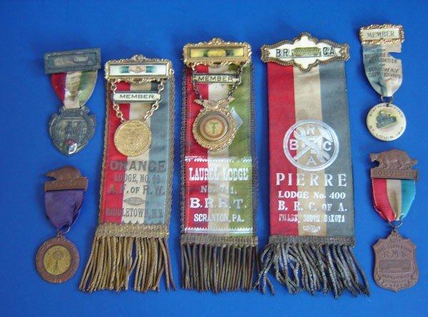 57: 11 Antique  Medals