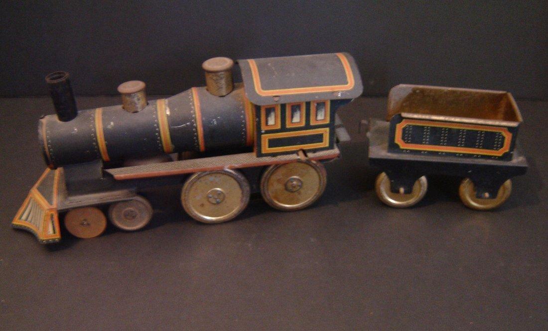52: Vintage Tin Toy Locomotive And Tender