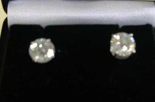 868: White Gold and Diamond Solitaire Earrings