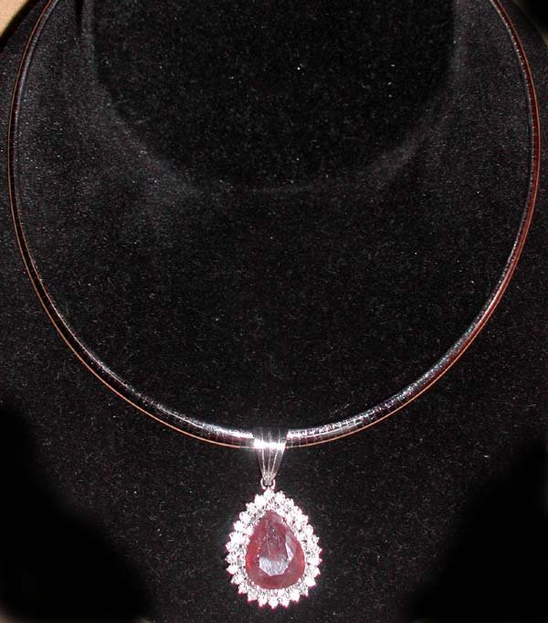 762: Gold, Ruby and Diamond Pendant on an Omega Necklac