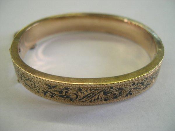 765: Enamel and Fourteen-Karat Gold Filled Bangle Brace