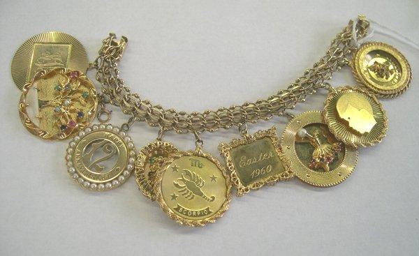 766: Lady's Fourteen Karat Yellow Gold Charm Bracelet