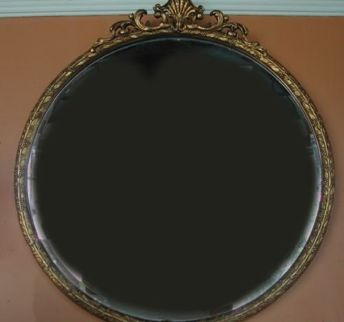 4: Large Circular Carved and Antiqued Giltwood Mirror