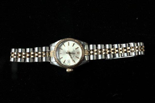 765: Yellow Gold Rolex Date Wristwatch