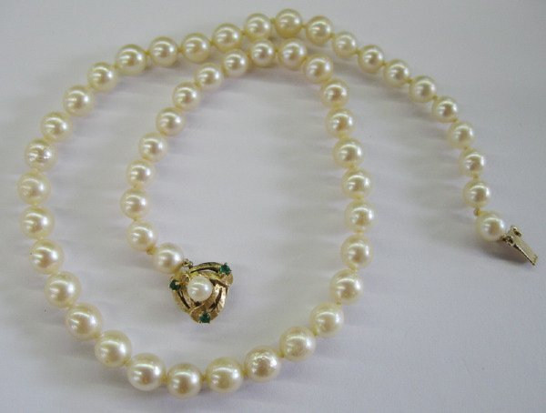 759: Cultured Pearls with Gold and Emerald Clasp
