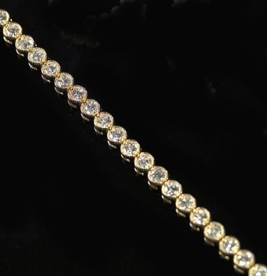 "815: Gold and Diamond ""Tennis"" Bracelet"