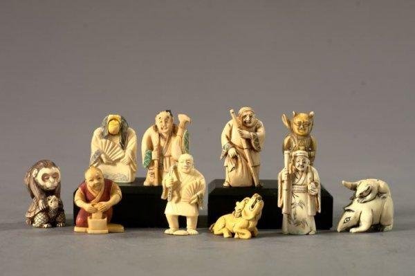 719: Japanese Meiji Carved and Oxidized Ivory Netsukes
