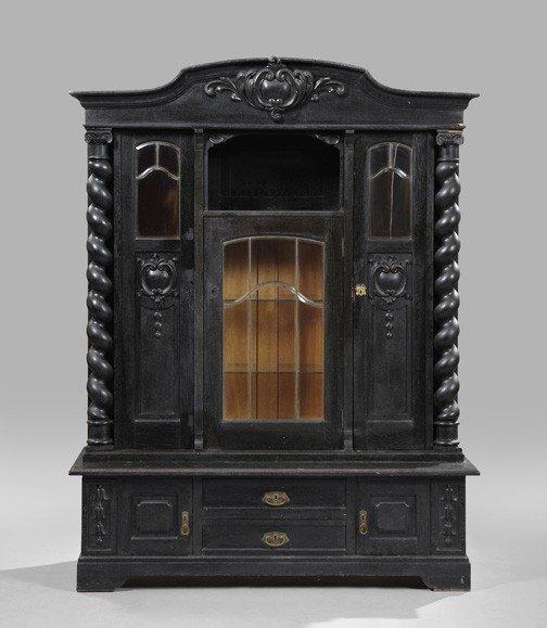 23: Large Continental Ebonized Oak Cabinet,
