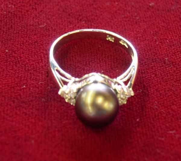 1242: Fourteen-Karat White Gold, Pearl and Diamond Lady