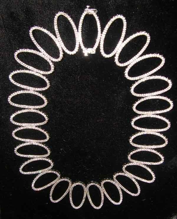 1249: Fourteen-Karat White Gold and Diamond Necklace