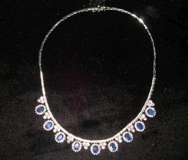 1255: Fourteen-Karat White Gold, Sapphire and Diamond N