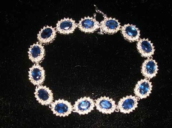 1256: Fourteen-Karat White Gold, Sapphire and Diamond L