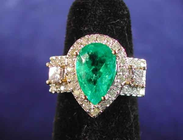 679: Gold, Emerald and Diamond Dinner Ring