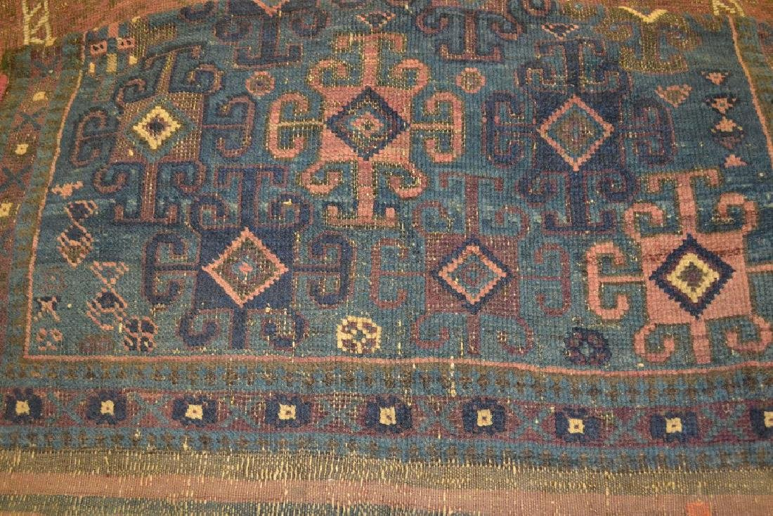 Small Belouch rug with blue ground and another similar