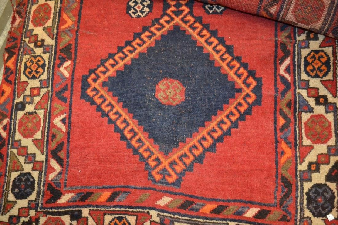 South West Persian rug with medallion design on red
