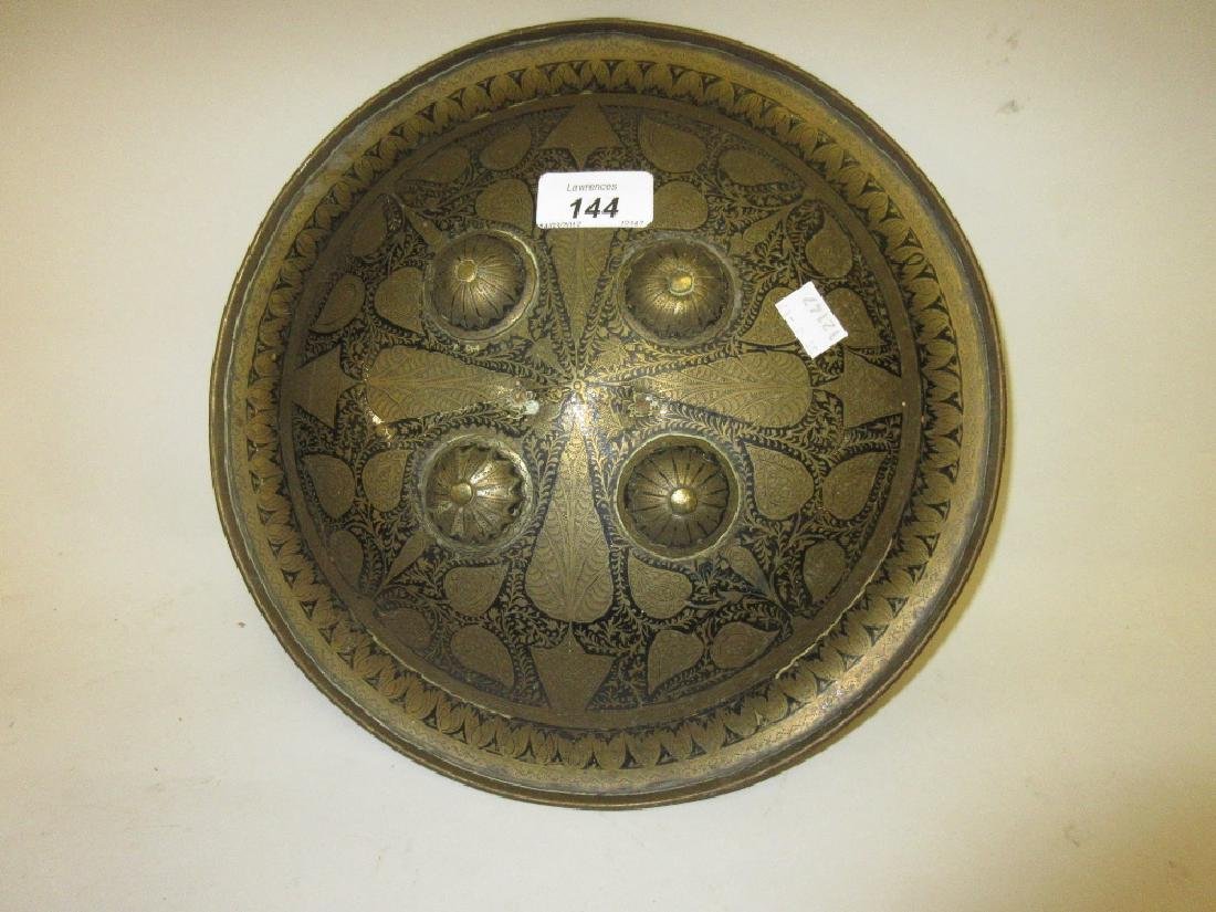 Small Persian brass shield with engraved and black