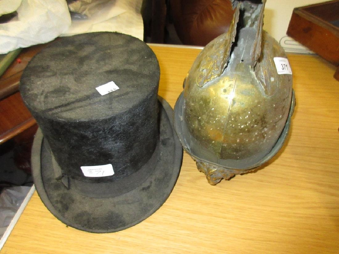 Roman style brass helmet and a top hat