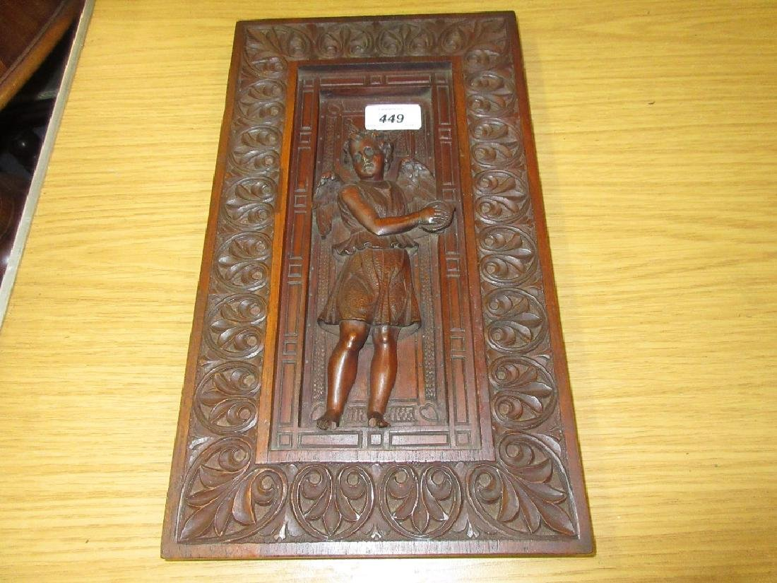 Small 19th Century carved walnut panel decorated with