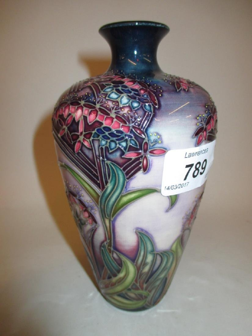 Similar larger late Moorcroft vase of stylised floral