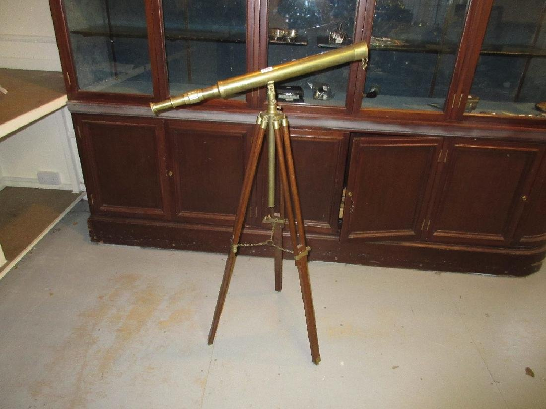 Reproduction brass telescope on a brass mounted folding