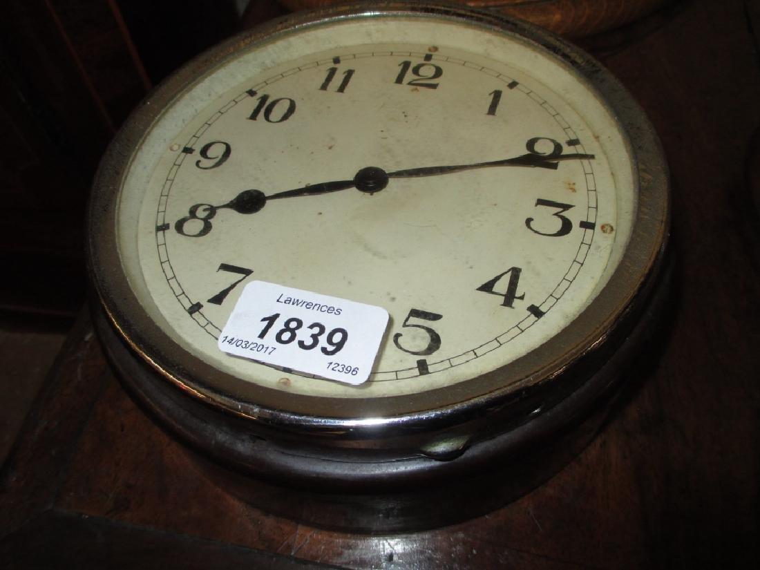 Small circular Bakelite cased bulk head clock with a