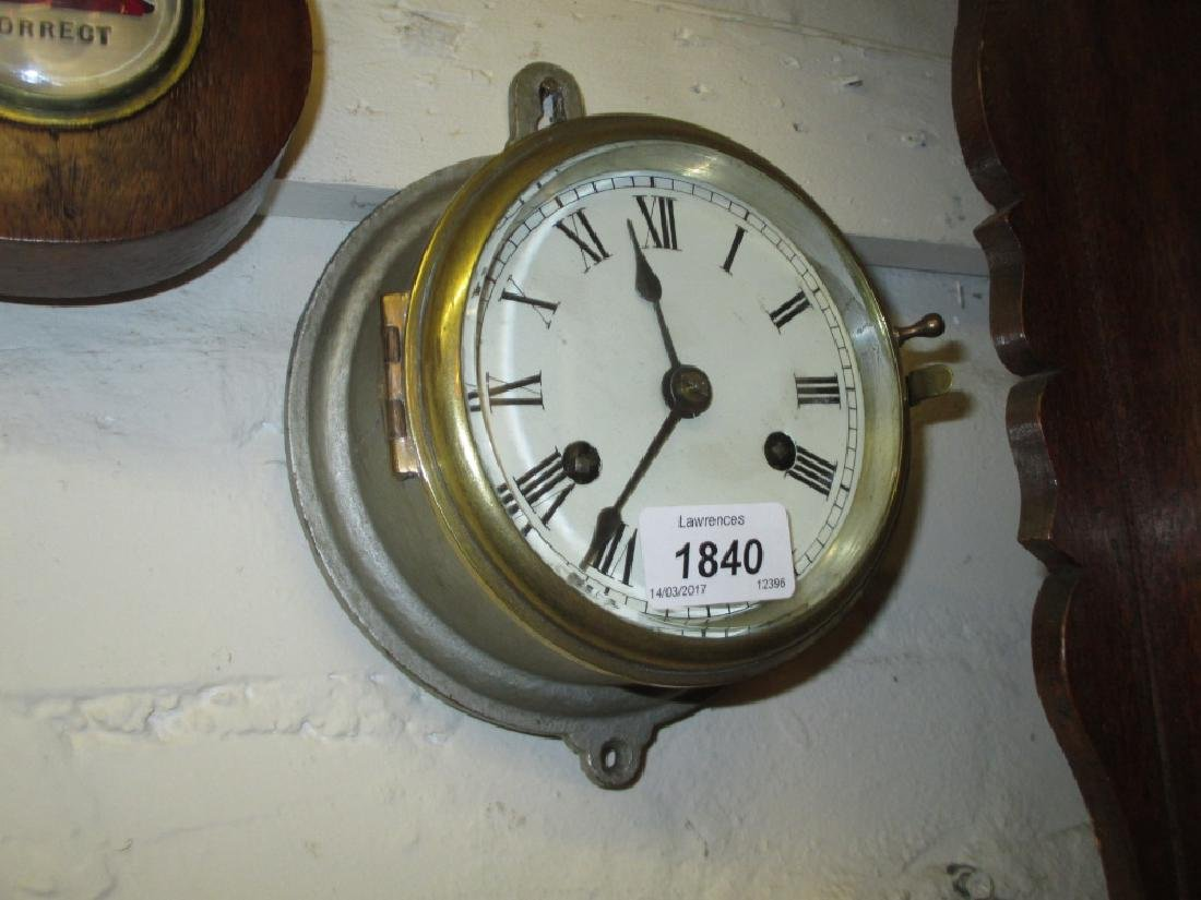 Small silvered metal cased ship's bulk head clock with