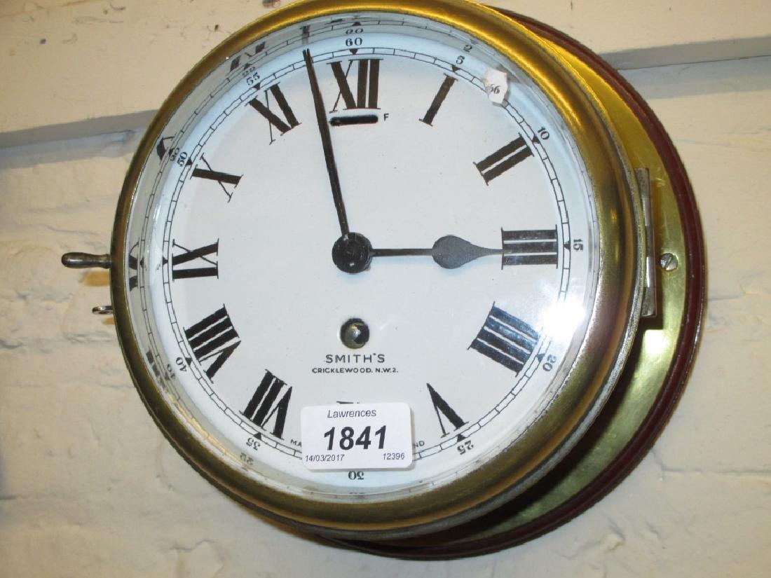 Mahogany and brass ship's bulk head clock, the enamel