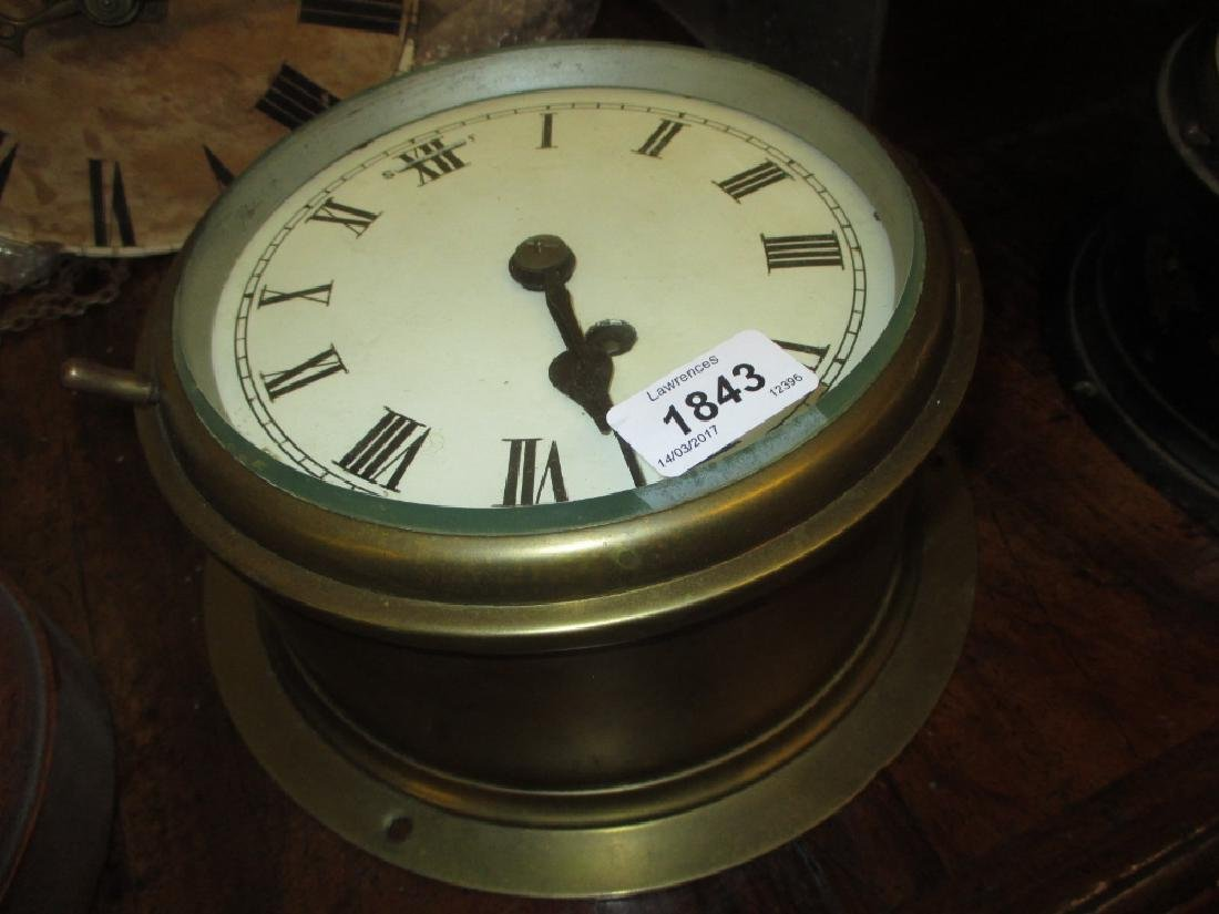 Brass cased ship's bulk head clock, the enamel dial