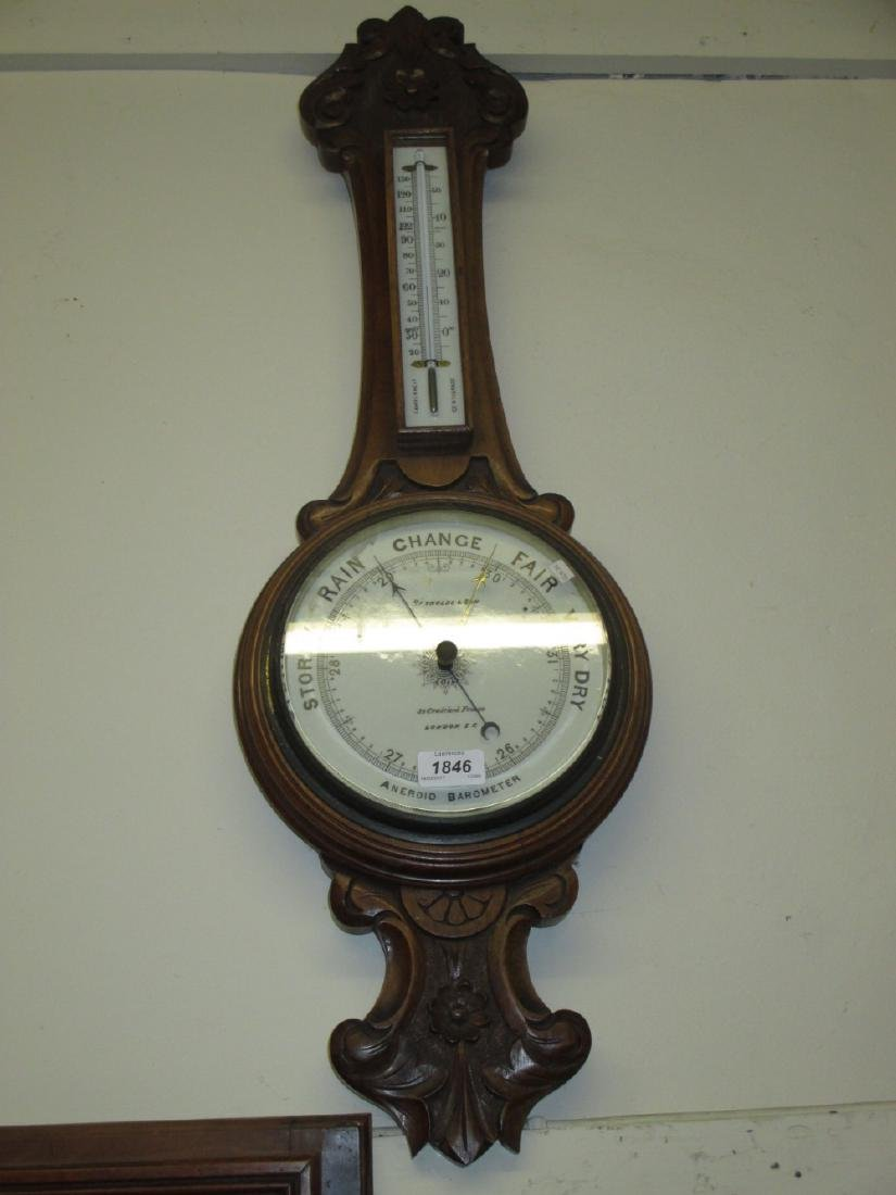 Early 20th Century carved walnut aneroid barometer /