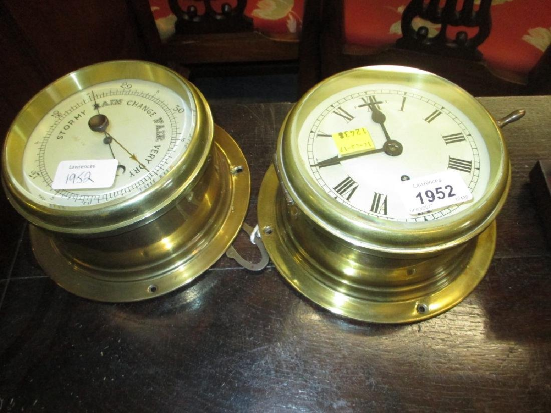 Ship's circular brass single train bulkhead clock,