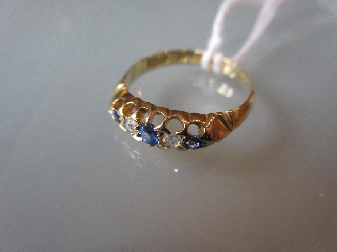 Edwardian 18ct gold five stone sapphire and diamond