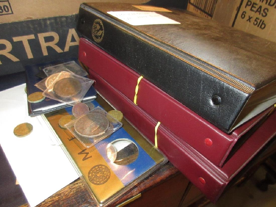 Folder containing a collection of farthings and half