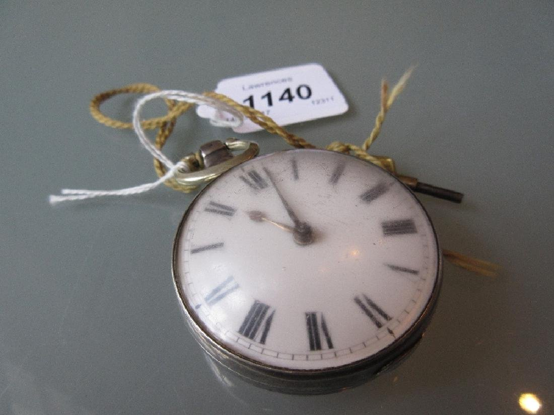 Antique pair cased silver pocket watch with key having