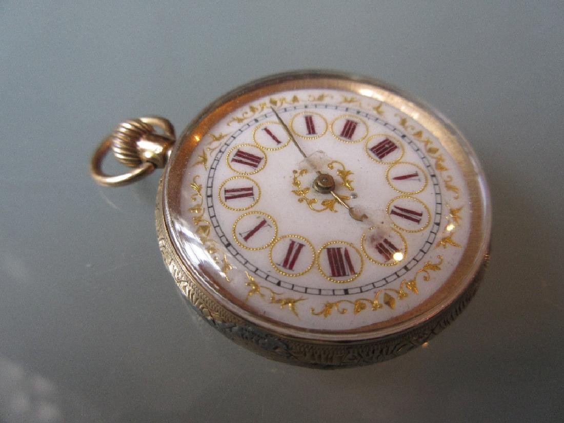 Ladies 14ct Yellow gold floral engraved fob watch by