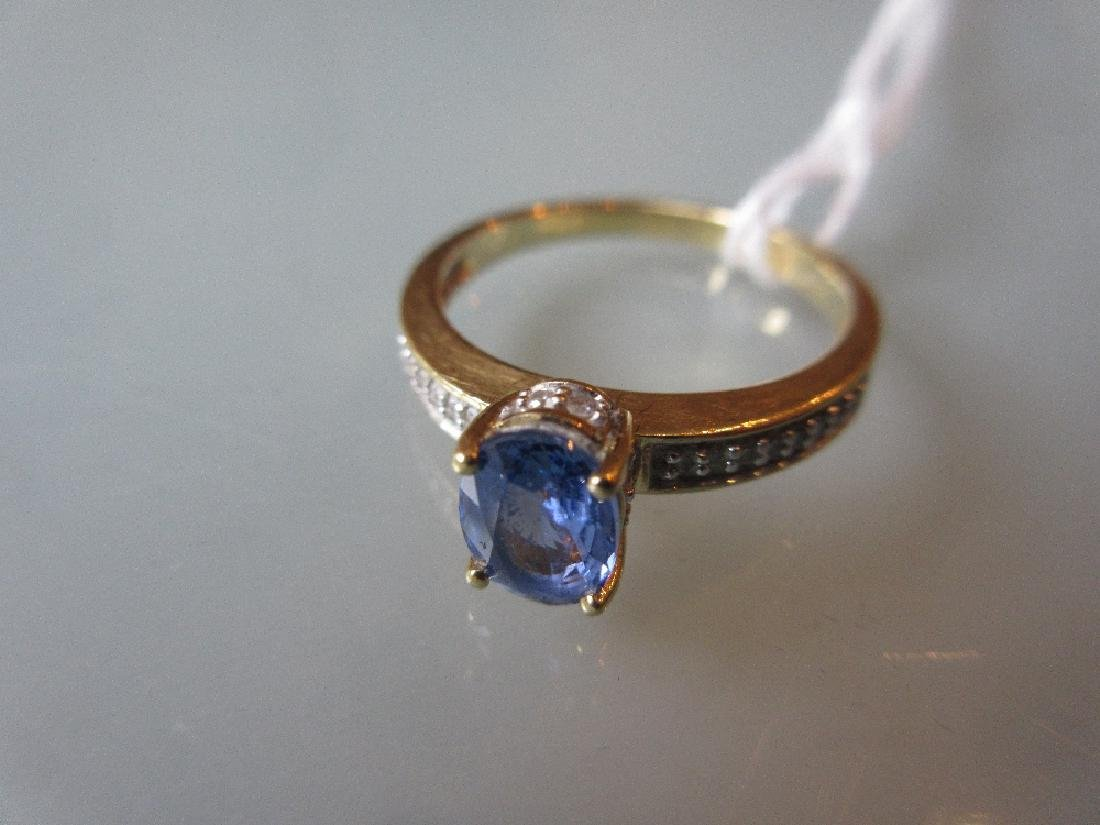 18ct Gold ring set oval sapphire with diamond set